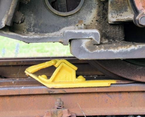 Bremsklotz auf Zugschiene